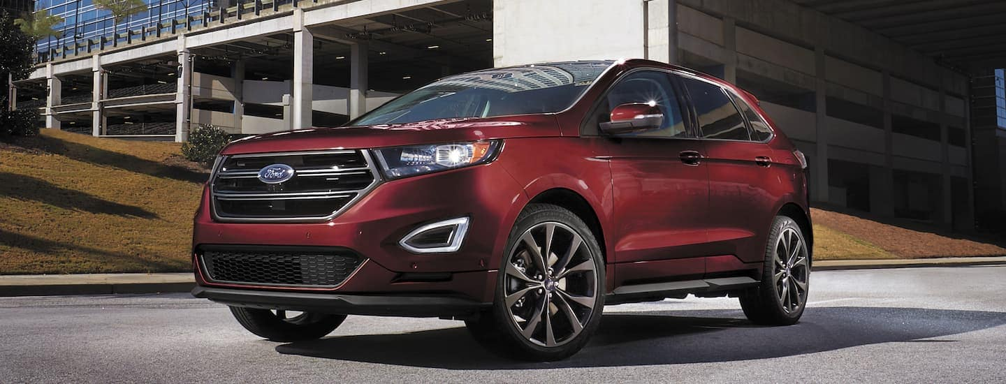 A red 2017 Ford Edge is parked under an overpass near Philadelphia, PA.
