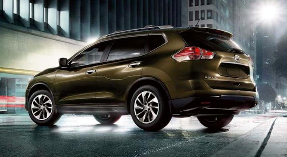 A brown 2016 Nissan Rogue is parked in Philadelphia, PA, at night.