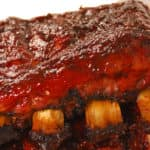 Two slabs of delicious BBQ spare ribs with dipping sauce