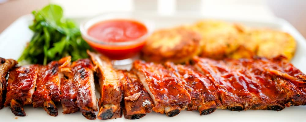 BBQ ribs on white plate. BBQ Tomball concept.