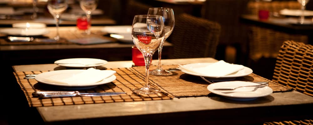 Dinner table with empty glasses and plates. Restaurants in Sugar Land, TX concept photo
