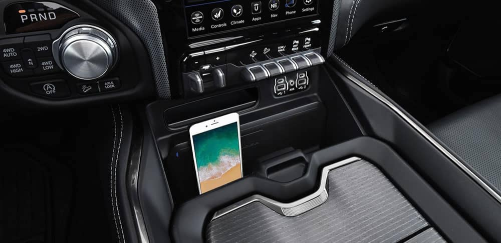 2020 Ram 1500 center console with lit-up phone in it