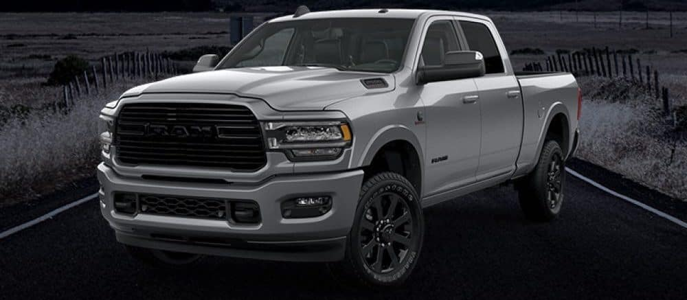 2020 RAM 1500 Night Edition in silver against dark background of road
