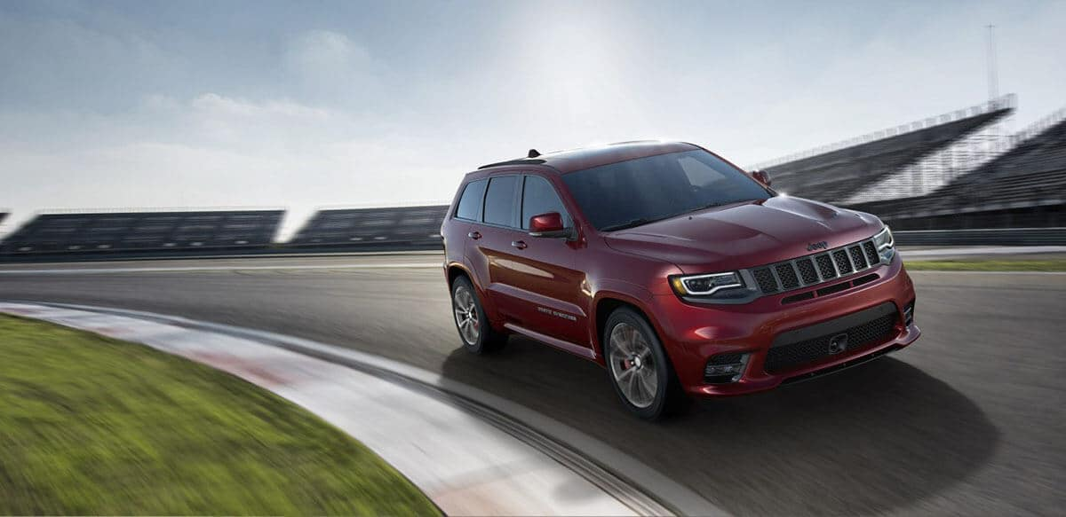 2018 Jeep Grand Cherokee driving fast around a curve track