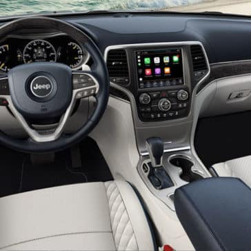Interior front seating and dashboard of a 2018 Jeep Grand Cherokee