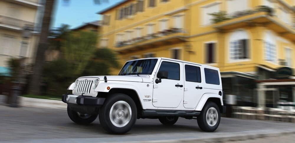 2018 Jeep Wrangler JK driving down a suburban street