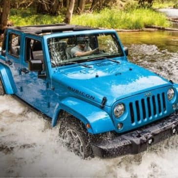 2018 Jeep Wrangler JK off roading through muddy water