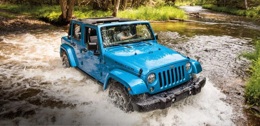 2018 Jeep Wrangler JK off roading through muddy water
