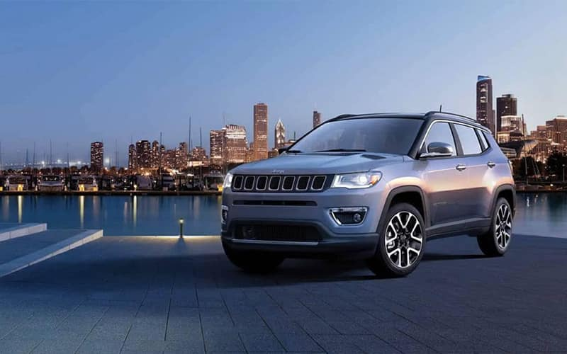 2019 Jeep Compass parked with city in background
