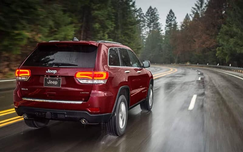2019 Jeep Grand Cherokee driving on wet road