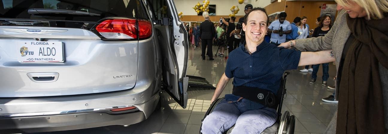Aldo Amenta receiving his wheelchair accessible van from Palmetto57 Nissan
