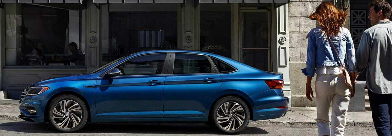 2019 VW Jetta parked outside of storefront window