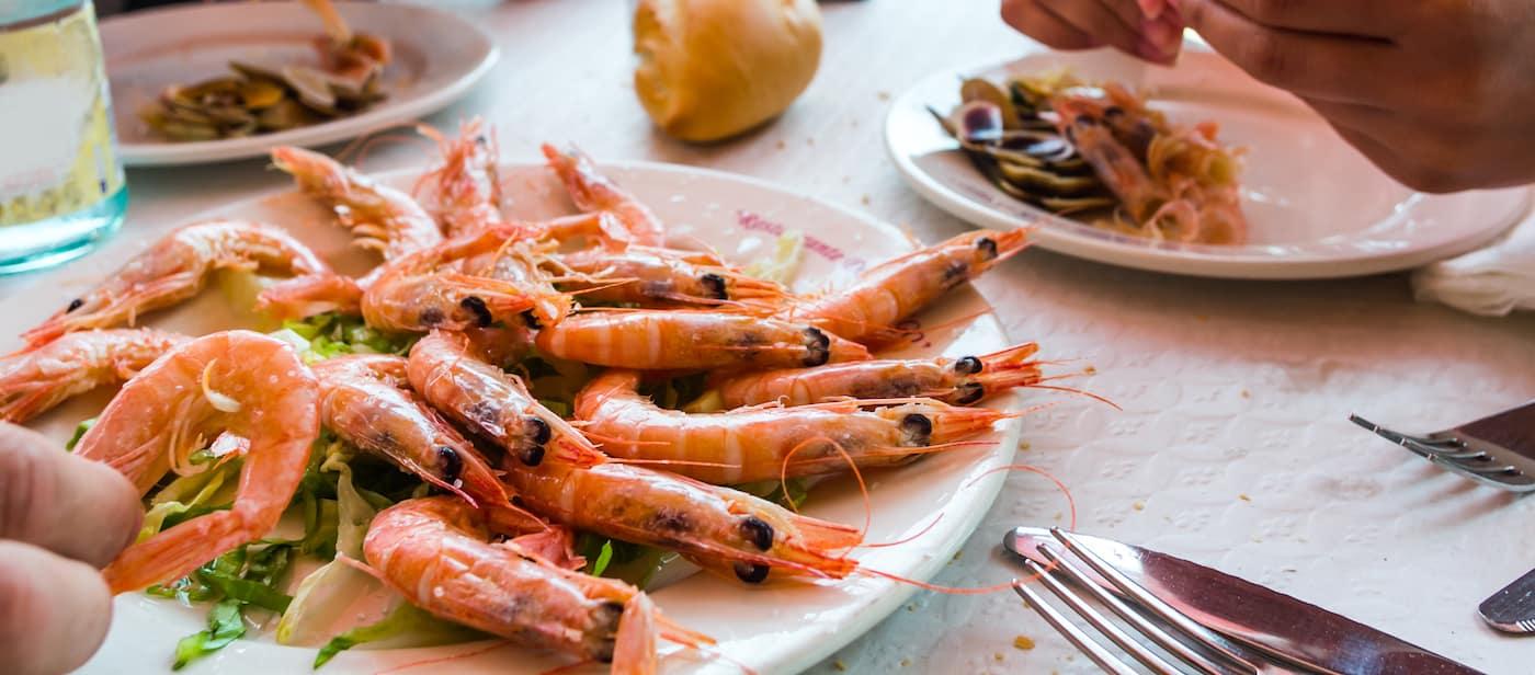 friends eating shrimp together