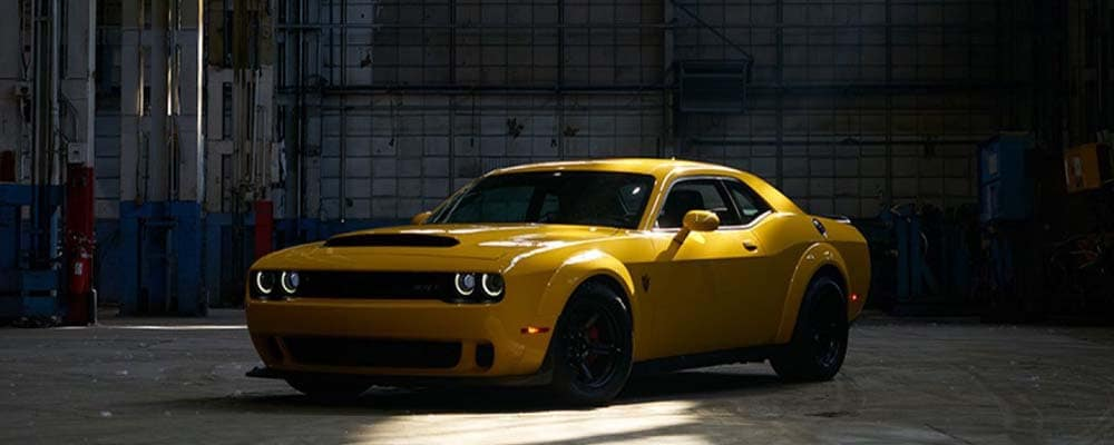 Yellow 2018 Dodge Challenger Inside a Service Garage
