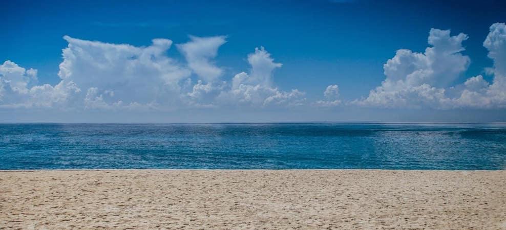 Sandy beach along oceanfront on a clear day