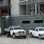Ram work trucks parked at construction site