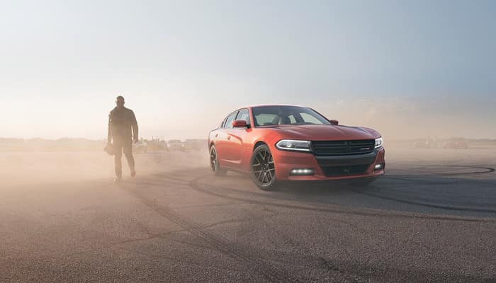 Man Standing Next to 2019 Dodge Charger