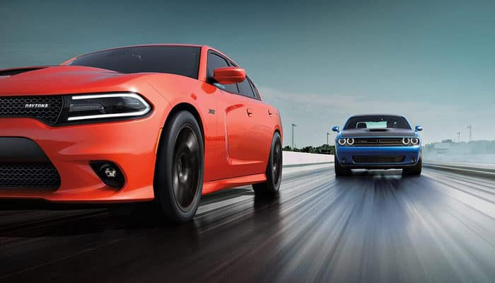 2019 Dodge Chargers Driving On Race Track