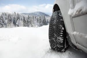 Close-up image of a tire in the snow.