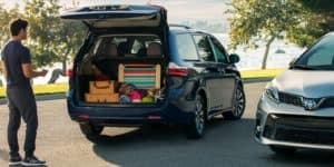 Image of the open trunk of a 2019 Toyota Sienna packed with picnic items.
