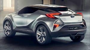 Image of a silver 2019 Toyota C-HR parked at night.