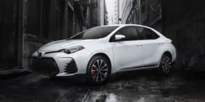 Image of a white 2019 Toyota Corolla X Series in an alleyway.