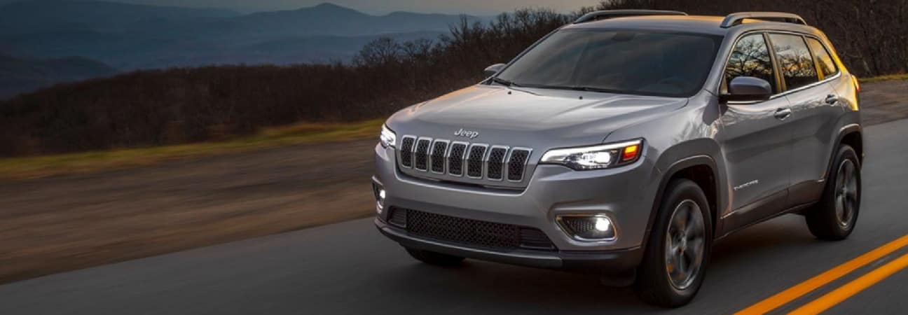 The 2019 Jeep Cherokee driving down the road.