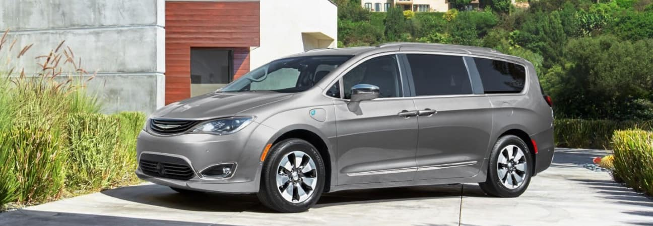 Silver 2019 Chrysler Pacifica parked in residential driveway