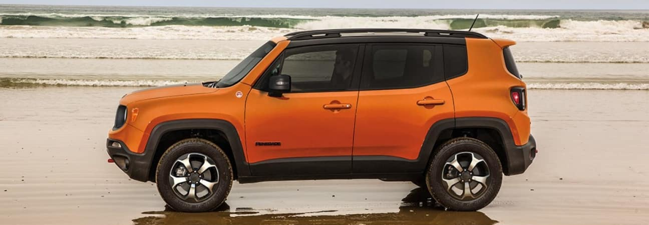 Orange 2019 Jeep Renegade on beach shore
