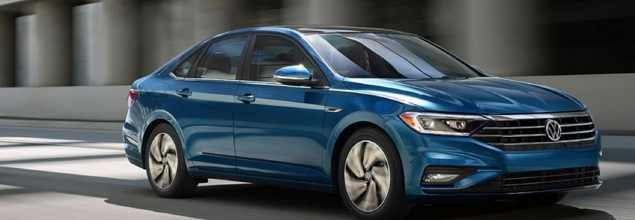 The 2019 VW Jetta driving down the road.