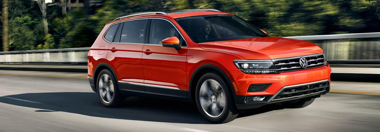 Orange 2018 Volkswagen Tiguan driving down the highway