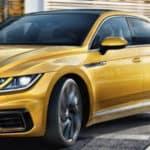 Gold 2019 Volkswagen Areton rounding street corner