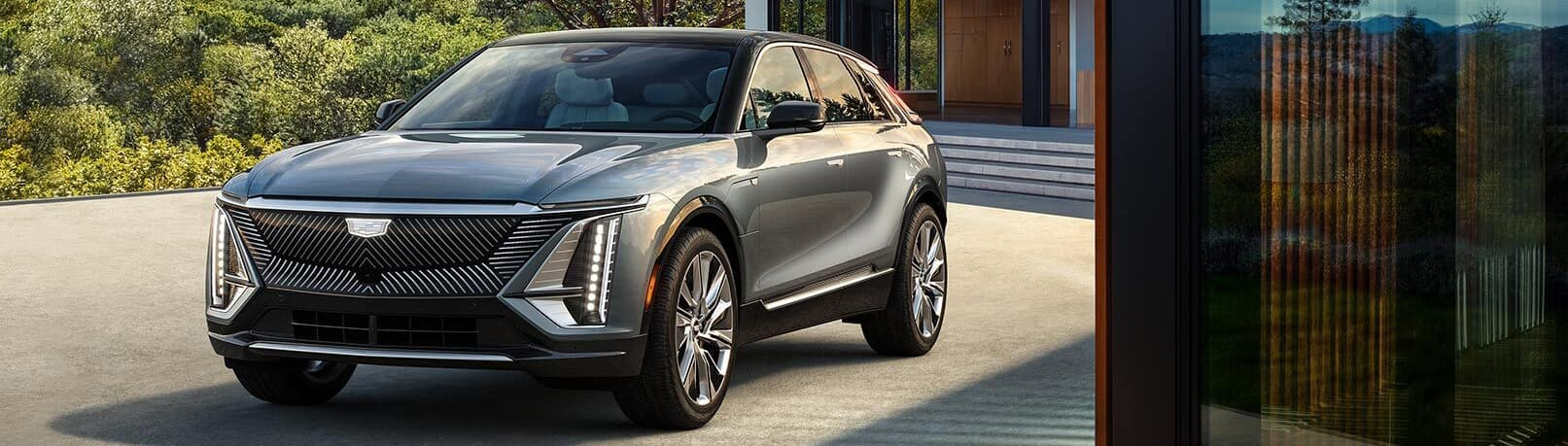 2023 Cadillac Lyriq in silver in front of a building.