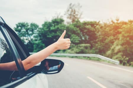Car buyer giving thumbs up
