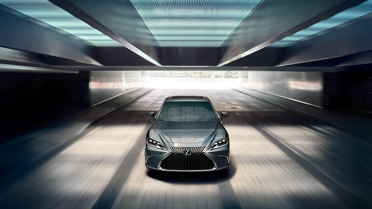 Image of a silver Lexus ES sedan driving in a tunnel.