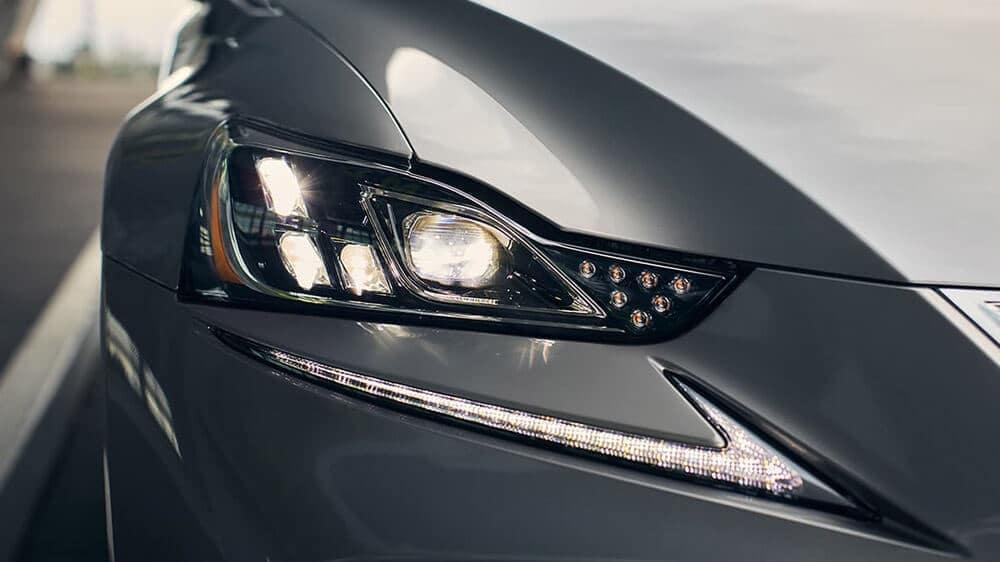 Close-up of a Lexus IS headlight.